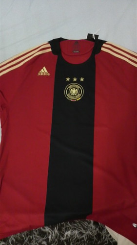 bought this Germany away jersey today. my fav colour! :D