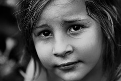 Days of innocence (millagios) Tags: portrait girl monochrome face smiling blackwhite child looking cutie
