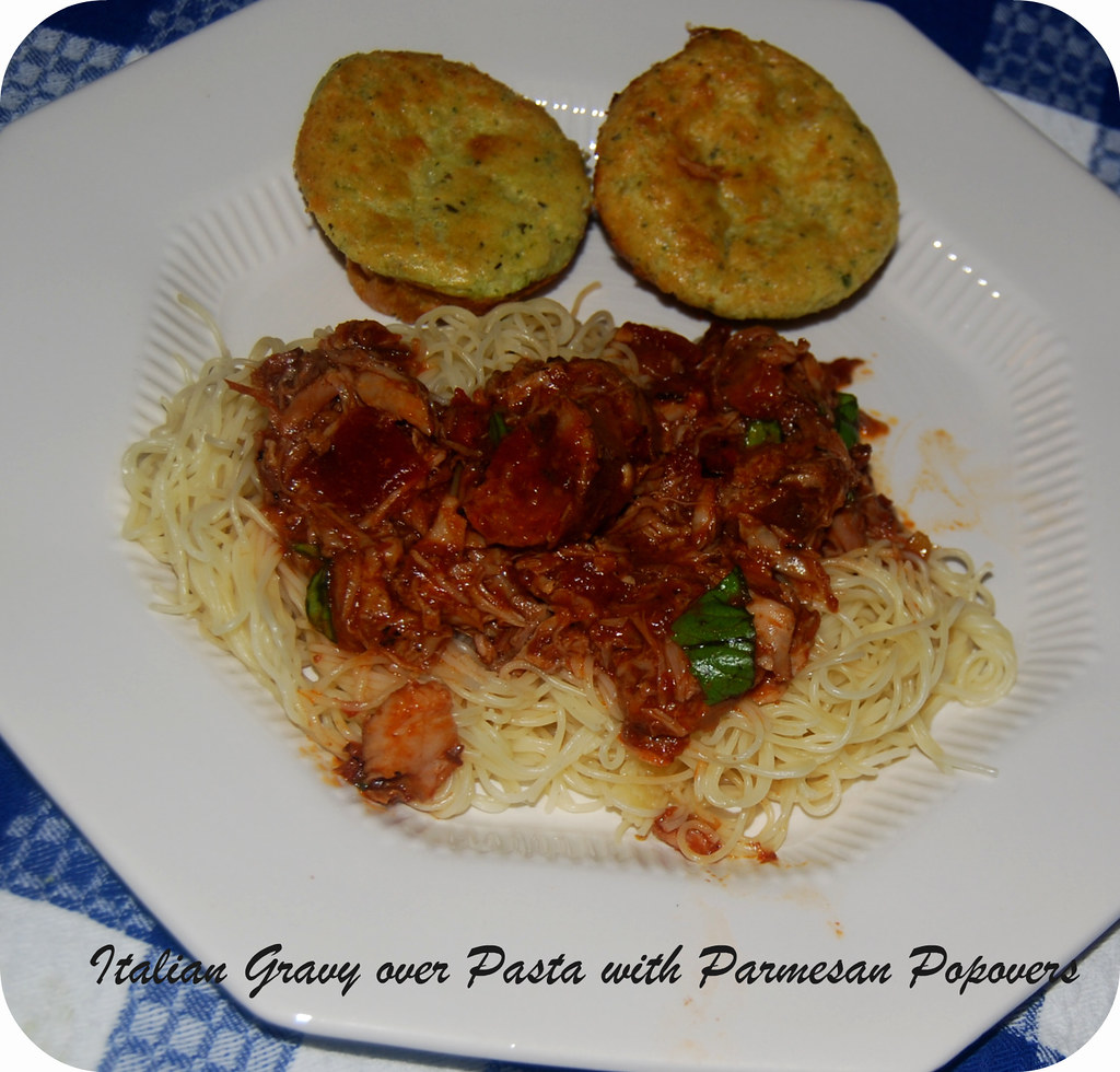 Italian gravy over pasta and parmesan popovers