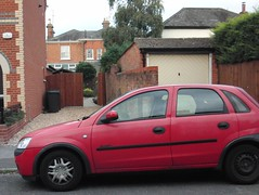 small car bocking 2 driveways at once