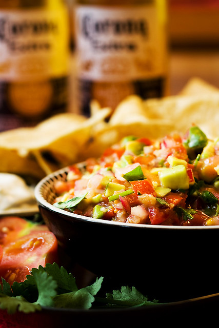 Salsa with nachos and beer
