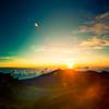 House of the Sun (~ superboo ~ [busy busy]) Tags: morning sky sun mountain green clouds sunrise volcano hawaii golden rocks bright top horizon warmth windy maui explore haleakala crater valley flare redhill summit chilly tropics blazing haleakalanationalpark