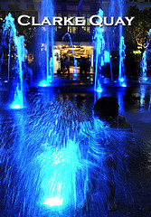 A splashing good time at Clarke Quay by the fountain (williamcho) Tags: friends tourism water fountain mall singapore child entertainment afterdark clarkequay d300 blueribbonwinner foodbeverage astoundingimage williamcho 1850mmsigmasingaporeriver