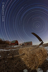 straw and scythe (postpurchase) Tags: snow barn march michigan farm annarbor fisheye 2010 strawbale extensioncord scythe startrail washtenaw acadapter eos50d samyang8mm timerintervalometer 609minutesin7minuteexposures weebitanachronisticperhaps