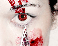 Red Eye (Madelaine Grambow Photography) Tags: red white black eye halloween face closeup catchycolors blood knife killer horror blade bloody splatter splattered