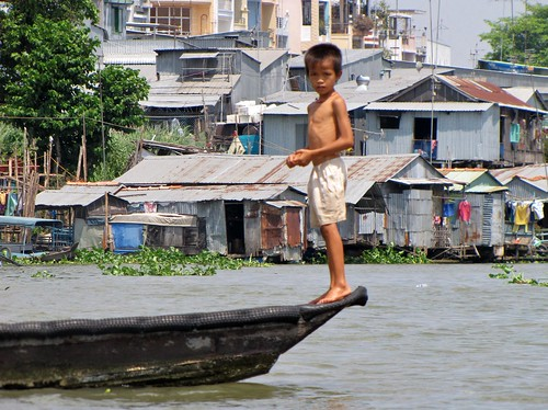 Boy on Tip of Boat