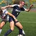 Boston University's Taylor Nichols tries to get the ball from University of Connecticut's Danielle Dakin