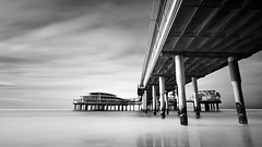 Scheveningen Pier - V (DolliaSH) Tags: city longexposure trip travel sea vacation urban holiday seascape holland color tourism beach water colors architecture strand canon photography photo topf50 europe foto tour place photos scheveningen nederland thenetherlands noordzee playa denhaag visit location tourist le journey northsea destination traveling visiting topf150 topf100 plage thehague spiaggia touring ranta zuidholland canonefs1022mmf3545usm southholland 2000views 50d nd110 canoneos50d dollia dollias sheombar plyazh dolliash bw10stopsolidndfilter