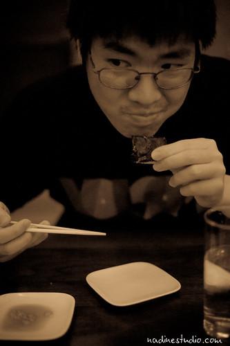 eating an uni/sea urchin at uchiko