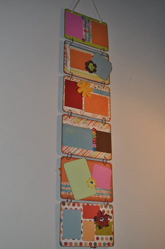One side of my wall hanging, there are six panels all decorated in bright colors and there are spaces for pictures on each