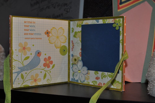 the inside of the cd box, one side has a bird with a quote from Henry David thorough that says Be true to your word, your work and to your friends. The other side has a place for a picture