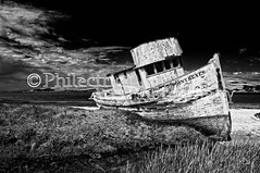 Point Reyes 9 (Philectric Arts) Tags: california sea abandoned beach photoshop bay boat ship antique ghost odd shipwreck abandon solo unknown lone beached nik lonely stranded infamous attraction relic lightroom tomalesbay tomales ghostship peachpit nikcolorefex philectricarts philectric nikhdrefex peachpitpublishers
