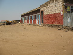 Roadside Hotel (aaron.knox) Tags: africa road building hotel highway parkinglot kenya motel massai maasai fromacar riftvalley b3 greatriftvalley
