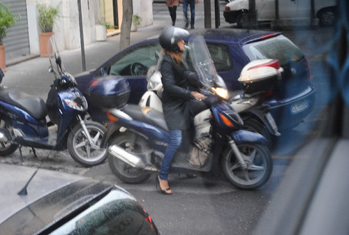 moped - woman - cigarette