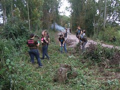 Students clearing vegetation from alongside the ballasted trackbed