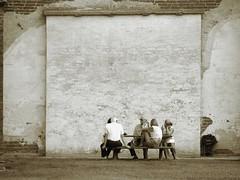 Quattro chiacchiere (Il cantore) Tags: people bw muro wall sepia table blackwhite bn persone chatting tavolo bianconero seppia chiacchiere sitted sedute 15challengeswinner canoniani