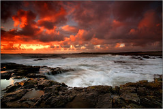 Sunset over Porthcawl (opobs) Tags: sunset sky beach water southwales wales seaside sand october rocks pebbles explore canon5d gitzo ogmore valeofglamorgan 2010 bridgend anglefinder ogmorebysea 1740mml wetknees ogmorebeach opobs cokinxpro traethogwr michaeljstokesawpf
