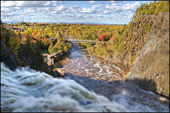 Rainbow in the fall (Guylaine Begin) Tags: park bridge autumn canada fall automne river landscape rainbow 2000 fallcolors rivire waterfalls qubec cascades pont 100 paysage parc chute hdr bsl gettyimages 136 arcenciel 114 couleursdautomne chutedeau rivireduloup bassaintlaurent 2239 basstlaurent hdrtonemapped parcdeschutesderivireduloup thefallsparkofrivireduloup chutederivireduloup