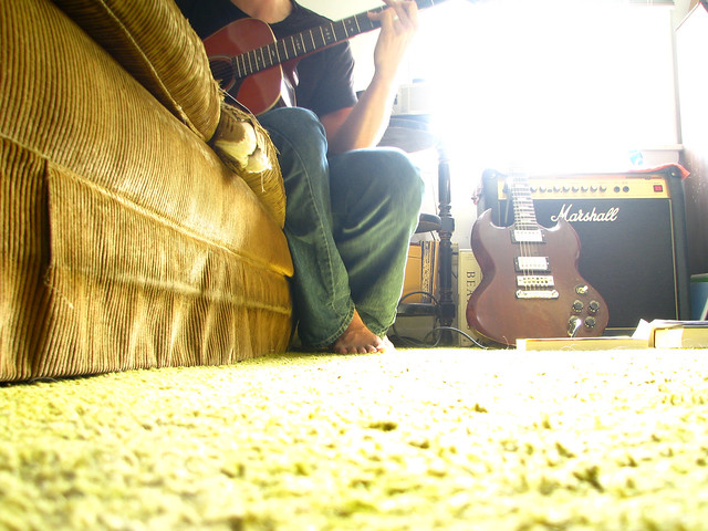 b. playing guitar
