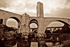 Besalu Bridge / Puente de Besal.- (ancama_99(toni)) Tags: pictures old trip travel bridge sky espaa art history water yellow arquitetura sepia architecture photoshop vintage geotagged puente photography gold photo spain arquitectura agua nikon espanha europa europe foto photos antique picture photographic catalonia girona cielo fotos architektur pont layers catalunya 1855mm fotografia nikkor espagne catalua catalan spanien spagna gerona pasoscatalans 2010 besalu  fotografas d60 besal catalogne 10favs 10faves nikkor1855 nikond60   holidaysvacanzeurlaub ancama99