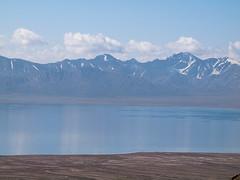 Chatyr-Kul lake (Evgeni Zotov) Tags: blue cloud mountain lake snow water landscape asia mount shore kyrgyzstan tianshan kirghizistan kirgistan kirgizia kirgizistan kirgizi kirgisistan  kirguistan kirghizia chatyrkul krgzistan quirguisto