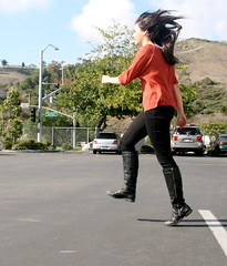 skipping around the school parking lot (Keemia Kaboli) Tags: orange hair jump boots air skipper jeans pico twirl stare skip sanclemente skipping skipped sanclementehighschool sanclementeparkinglot