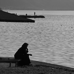 contemplation at sunset (delikizinyeri) Tags: woman lake canon turkey iznik 400d