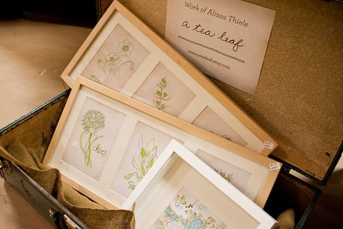 Herb art framings displayed in suitcase