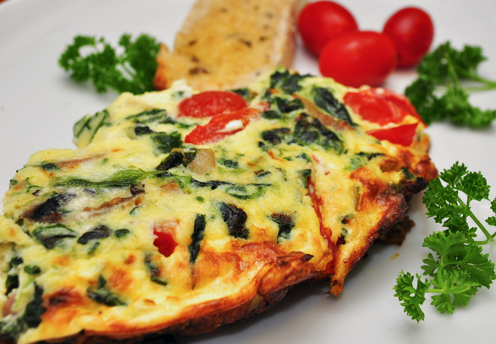 Mmm...spinach feta frittata by jeffreyw, on Flickr