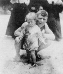 Image of Our grandfather with his young son on the beach