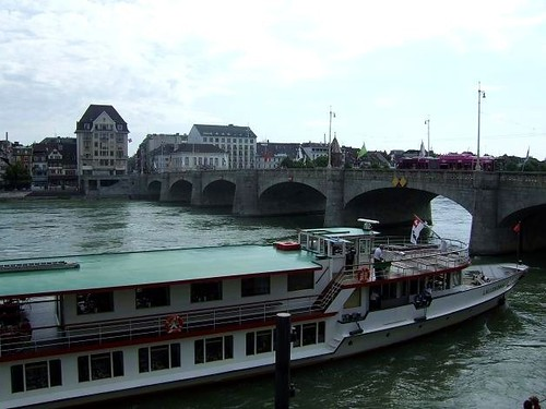 Mittlere Brücke, Basel and boat on river Rhine