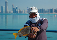 Abu Dhabi fisherman (Leonid Yaitskiy) Tags: city fish man face happy fishing fisherman hands background uae east catch filipino tight middle abu hold profession dhaby