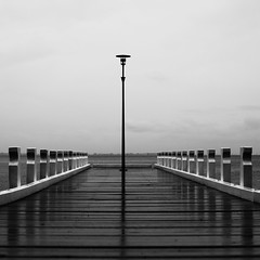I Remember (Brendan_Timmons) Tags: light bw wet water clouds dark pier blackwhite pole symmetrical posts canon50mmf14 canon5dmkii