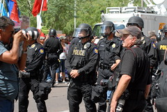 UP FRONT (ONE/MILLION) Tags: city arizona news streets phoenix photo google search riot interesting media flickr downtown cops photos police gear security equipment civil illegal guns law immigrants enforcement disobedience immigration weapons helmets onemillion williestark sb1070