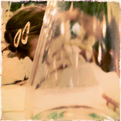 The wait (adartee   www.imik.it) Tags: white glass dinner hair lunch reflex bottle clear babygirl wait cena trasparente viso hairpin vetro capelli attesa pranzo riflesso bambina mollette bottiglia attendere