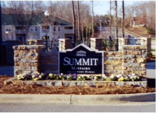 stone columns and stone entrance sign border in Raleigh, North Carolina