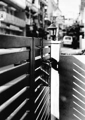 (ClaWeD One) Tags: blackandwhite bw stilllife film wall bar mailbox 35mm 50mm nikon bars gate iron shadows mail kodak bangalore grain streetphotography gritty chain filmcamera grainy manualfocus nikonfm2 fm2 50mm18 irongate 50mmf18 streetstuff ironbars fm2n nikkor50mm filmslr streetsofbangalore niftyfifty filmisnotdead nikonfilm banashankari colorplus blackandwhitestilllife indianstreetphotography filmrocks bangalorestreets kodakcolorplus nikonfilmcamera willneverdie iamlovingit stilllifeinblackandwhite playofshadows barsoflight playofshadow thefirstroll manuallyfocussed banashankari3rdstage banashankariiiirdstage