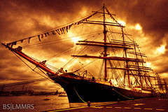 The ship is on fire (Bas Lammers) Tags: amsterdam clouds fire harbor boat sails tallship hdr lightroom ijmuiden extremepostprocessing sail2010 mygearandmepremium mygearandmebronze mygearandmesilver mygearandmegold mygearandmeplatinum mygearandmediamond