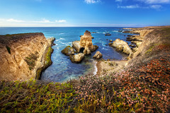 View from the Edge of the Cliffs - Montana De Oro State Park, CA (Daniel Peckham) Tags: ocean california statepark ca chimney cliff water island coast rocks waves view pacific rocky wideangle photoblog pacificocean coastal vista montanadeoro coastline cave morrobay 16mm viewpoint hdr sanluisobispo foreground cliffy chimneyrock rockycoast montanadeorostatepark caveisland