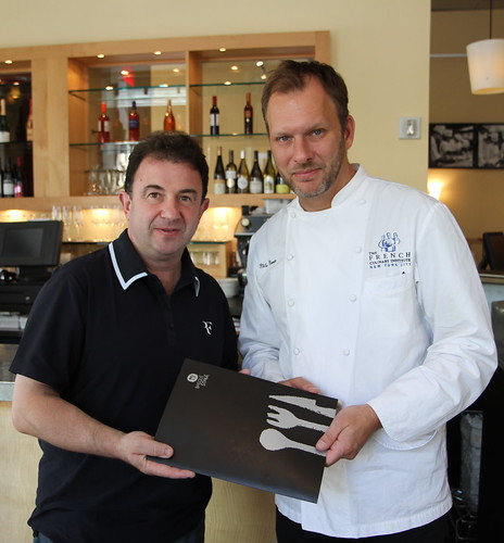 Chef Berasategui gives BasqueStage documents to Chef Norin