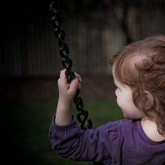 Swinging the afternoon away (-JosephB-) Tags: park red girl dark square child hand looking purple arm leah 11 swing pale chain swinging 2010 24105mm 50d