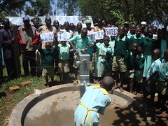 Eburenga primary school,parents,teachers and students giving thanks to the water project during hand over ceremony