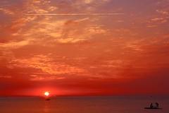 A remi (meghimeg) Tags: red sun rot sunrise boat barca ship alba nave rowing sole rosso royo dianomarina 2011 remare abigfave colorphotoaward