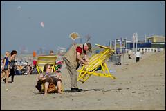 This is it, i'm leaving (Amsterdam Today) Tags: sea en oktober sun holland beach netherlands dutch up yellow strand sand chair october couple pentax seat zee tip zandvoort morpheus 2010 zand stel tipup klapstoel wegwezen k20d schaagen inklappen