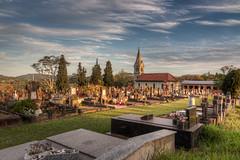 Graveyard Sunset (Bernardo Mller) Tags: sunset brazil church cemetery graveyard brasil sigma wideangle rs hdr novohamburgo 816 photomatix lombagrande 3exp