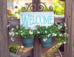"""Inside the gardener is the spirit of the garden outside."" (linda yvonne) Tags: california garden gate quote carmel cheerful planter welcomesign carmelbythesea bacopa informal containergardening residentialgardendesign michaelpgarofalo"