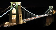 Clifton suspension bridge January 2010 (www.paul-green.org) Tags: city uk longexposure bridge winter england urban southwest west reflection building cars water colors architecture night digital bristol eos lights evening is darkness suspension unitedkingdom vibrant country victorian trails landmarks kingdom somerset riversevern photograph 7d vista gorge lighttrails usm avon clifton span harbourside listed towncentre brunel splendor isambardkingdombrunel isambard tollbridge avongorge f3556 canonusm canon7d efs18135mm