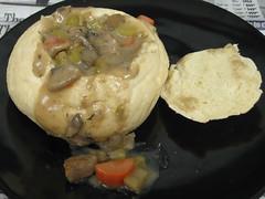 Beef stew in a bread boule