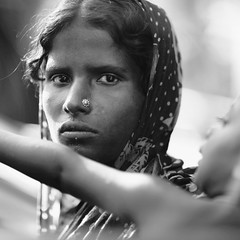Her WILD eyes (N A Y E E M) Tags: sheuli beggar mother eyes wild child look carwindow wellfood carpark digital monochrome street candid portrait gec chittagong bangladesh nayeemkalam canoneos5d canonef135mmf2lusm