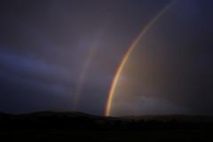 Rainbows at sunrise - Ingram, Northumbria (edbadle) Tags: england sky weather dawn countryside nationalpark rainbow northumberland northumbria ingram canon400d